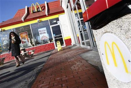 A woman walks out of a McDonald's restaurant in New York January 24, 2011. REUTERS/Shannon Stapleton