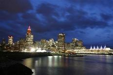 <p>Clouds gather above the night skyline of downtown Vancouver during the Vancouver 2010 Winter Olympics February 25, 2010. REUTERS/Greg Bos</p>