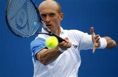 <p>Николай Давыденко на турнире Australian Open в Мельбурне 17 января 2011 года. Россиянин Николай Давыденко успешно стартовал на турнире Dubai Open, проходящем в ОАЭ. REUTERS/Mick Tsikas</p>