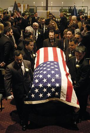 A casket containing the body of slain U.S. Immigration and Customs Enforcement (ICE) Special Agent Jaime Jorge Zapata is carried out of the Brownsville Events Center in Brownsville February 22, 2011. REUTERS/Brad Doherty/Pool