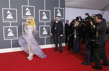 Lady Gaga poses on the red carpet at the 52nd annual Grammy Awards in Los Angeles January 31, 2010. REUTERS/Mario Anzuoni