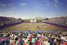 <p>An undated artist's impression shows the venue in Greenwich Park for the London 2012 Equestrian and Modern Pentathlon competitions. London 2012 organisers last week published artists' impressions of how some of the yet-to-be-erected temporary facilities will look once the 'greatest show on earth' hits town next year. The elegant, 17th century, Inigo Jones-designed Queen's House at Greenwich and the skyscrapers of Canary Wharf will be the backdrop for the equestrian arena with temporary stands on three sides like a horseshoe. A deck will have to be erected on scaffolding to counter a drop of several metres over the terrain and produce the required level playing field, as well as to minimise the effect on the park itself. REUTERS/LOCOG/Populous/Handout</p>