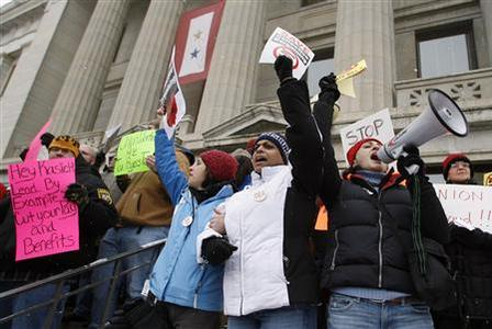 Union supporters (L-R) Nora Suder-Riley, Tiffany James and Merrin Richardson chant loudly during a rally opposing Senate Bill 5 that would weaken unions at the state capital in Columbus, Ohio, February 22, 2011. REUTERS/Mike Munden