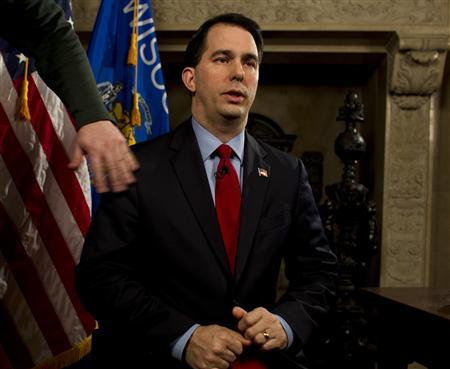 Wisconsin Governor Scott Walker pauses for a moment before he takes his seat in the governor conference room at the State Capital to give a fireside chat in Madison February 22, 2011. Walker gave the chat to explain his budget repair bill which has gotten so much attention. REUTERS/ Tom Lynn/ Pool