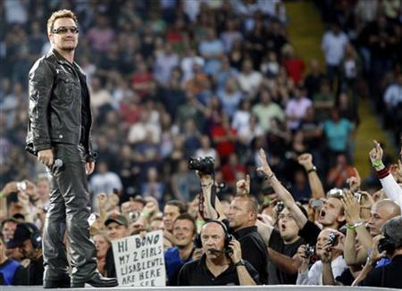Bono stands as U2 performs during their 360 Degree Tour in Frankfurt, August 10, 2010. REUTERS/Alex Domanski