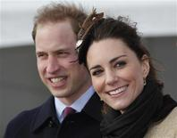 <p>Britain's Prince William and his fiancee Kate Middleton smile following a Naming Ceremony and Service of Dedication for the Royal National Lifeboat Instution's (RLNI) new Atlantic 85 Lifeboat, the 'Hereford Endeavour', at Trearddur Bay Lifeboat Station, in Trearddur Bay, Anglesey in north Wales February 24, 2011. REUTERS/Phil Noble</p>