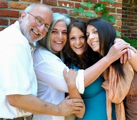 Alan Gross and his wife Judy pose with their daughters during a Friday Shabbat dinner in an undated photo. REUTERS/Family photo