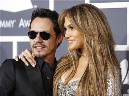 Jennifer Lopez and her husband Marc Anthony pose on arrival at the 53rd annual Grammy Awards in Los Angeles, California February 13, 2011. REUTERS/Danny Moloshok