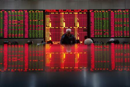 People look at an electronic board at a brokerage house in Shanghai February 25, 2011. REUTERS/Aly Song