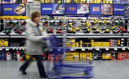 A customer passes a display of tools at a Lowe's store in Massachusetts, February 23, 2011. REUTERS/Brian Snyder