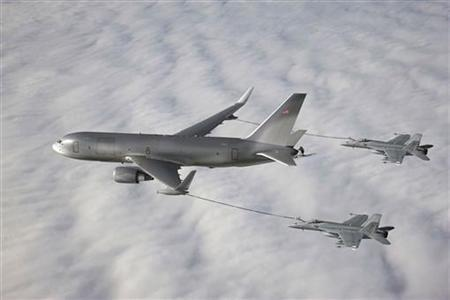 The Boeing 767-based NewGen Tanker is pictured simultaneously refueling two F/A-18 Super Hornet aircraft from the wing air refueling pods in this undated photo illustration, obtained on February 24, 2011. REUTERS/Boeing/Handout
