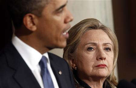President Barack Obama speaks about Libya while Secretary of State Hillary Clinton listens in the White House in Washington February 23, 2011. REUTERS/Kevin Lamarque