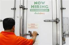 <p>A Fresh Direct employee makes a grocery delivery in New York City, May 6, 2010. REUTERS/Lucas Jackson</p>