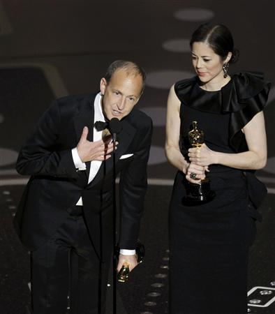 Charles Ferguson (L) and Audrey Marrs accept the Oscar for best documentary feature for ''Inside Job'' during the 83rd Academy Awards in Hollywood, California, February 27, 2011. REUTERS/Gary Hershorn