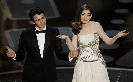 Co-host James Franco (L), best actor nominee for his role in ''127 Hours,'' and co-host Anne Hathaway stand onstage during the 83rd Academy Awards in Hollywood, California, February 27, 2011. REUTERS/Gary Hershorn