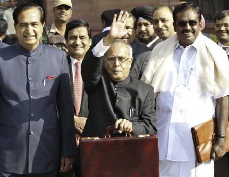 Finance Minister Pranab Mukherjee waves as he leaves his office to present the 2011/12 federal budget in New Delhi February 28, 2011. REUTERS/Vijay Mathur