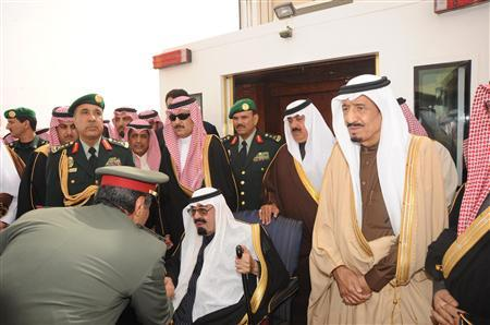 Saudi Arabia's King Abdullah (C, seated) is greeted by a Saudi officer on his arrival at Riyadh airport in this February 23, 2011 file photo. When Saudi King Abdullah arrived home last week, he came bearing gifts: handouts worth $37 billion, apparently intended to placate Saudis of modest means and insulate the world's biggest oil exporter from the wave of protest sweeping the Arab world. But some of the biggest handouts over the past two decades have gone to his own extended family, according to unpublished American diplomatic cables dating back to 1996. REUTERS/Saudi Press Agency/Handout/Files