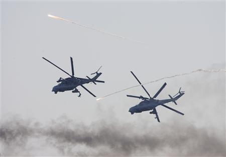 Belarussian army MI-24 military helicopters release flares at a firing range in Domanovo, some 200 km (124 miles) southwest of Minsk, October 21, 2008, in this file photo. The United Nations on February 28, 2011 accused Belarus of violating an arms embargo on Ivory Coast by delivering attack helicopters to the country for incumbent leader Laurent Gbagbo. REUTERS/Vasily Fedosenko