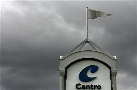 Rain clouds are seen behind a Centro sign in Sydney in this February 18, 2008 file photo. Private equity firm Blackstone Group will pay about $9.4 billion for the U.S. shopping mall assets of Australia's debt-laden Centro Properties after winning a three-way bidding contest, a source with knowledge of the transaction said on Monday. REUTERS/Mick Tsikas