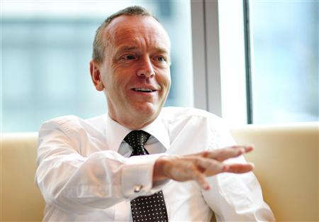 Singapore Exchange (SGX) chief Magnus Bocker speaks with Reuters journalists in Singapore March 1, 2011. Bocker said he did not plan to offer any more concessions in SGX's $7.7 billion bid to win control of Australian bourse operator, ASX. REUTERS/Harry Suhartono