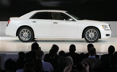 A Chrysler 300 is driven on to the stage during the press day for the North American International Auto show in Detroit, Michigan January 10, 2011. REUTERS/Rebecca Cook