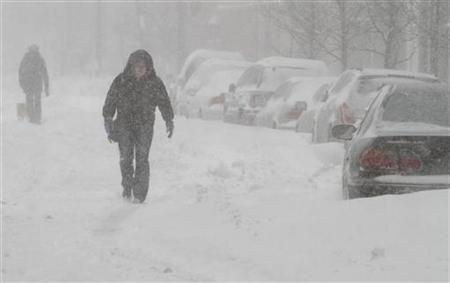 Pedestrians walk on the streets of Chicago after a major snowstorm February 2, 2011. REUTERS/John Gress