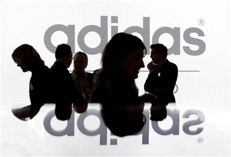 Shareholders' of Adidas Group are silhouetted in front of the company logo before the annual shareholder meeting in Fuerth near Nuremberg May 8, 2008. REUTERS/Michaela Rehle