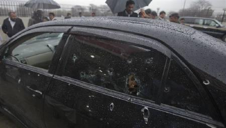 Security officials examine the bullet-riddled car of slain Pakistan's Minister for Minorities Shahbaz Bhatti outside the emergency ward of a hospital in Islamabad March 2, 2011. REUTERS/Faisal Mahmood