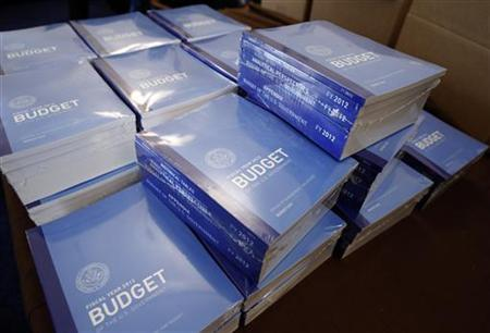 Copies of President Obama's 2012 budget are unveiled on Capitol Hill, February 14, 2011. REUTERS/Jason Reed