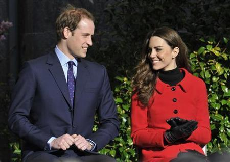 Britain's Prince William and his fiancee Kate Middleton listen to speeches during their visit St. Andrews University in Fife, Scotland February 25, 2011. REUTERS/Toby Melville