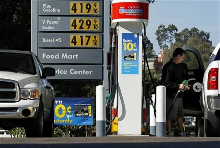 A man stands near gas prices at a petrol kiosk in Dal Mar, California, March 1, 2011. REUTERS/Mike Blake