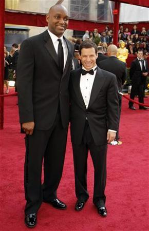 ''The Blind Side'' producers Broderick Johnson (L) and Andrew Kosove arrive at the 82nd Academy Awards in Hollywood, March 7, 2010. REUTERS/Brian Snyder