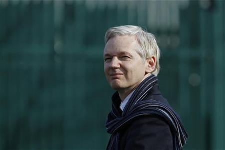 WikiLeaks founder Julian Assange reacts as he addresses the media outside Belmarsh Magistrates' Court in London February 24, 2011. REUTERS/Stefan Wermuth