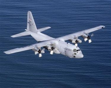 An undated file photo shows a U.S. Air Force C-130 cargo plane in flight. When Lockheed Martin wanted to sell C-130 military transport planes to the government of Chad in early 2007, the U.S. embassy in N'Djamena was ready to lend a hand. In ensuing years, the Chadian government and people connected to Lockheed worked relentlessly to get the deal done. REUTERS/Tech. Sgt. Howard Blair-USAF/Handout/Files