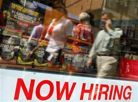 Pedestrians walk past a ''Now Hiring'' sign in the window of a GNC shop in Boston, Massachusetts September 1, 2010. REUTERS/Brian Snyder