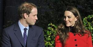 <p>Britain's Prince William and his fiancee Kate Middleton listen to speeches during their visit St. Andrews University in Fife, Scotland, February 25, 2011. REUTERS/Toby Melville</p>