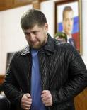 <p>Президент Чечни Рамзан Кадыров в Грозном 16 декабря 2009 года. Депутаты парламента Чечни в субботу единогласно одобрили продление еще на пять лет полномочий главы республики 34-летнего Рамзана Кадырова, поддерживаемого Кремлем. REUTERS/Denis Sinyakov</p>