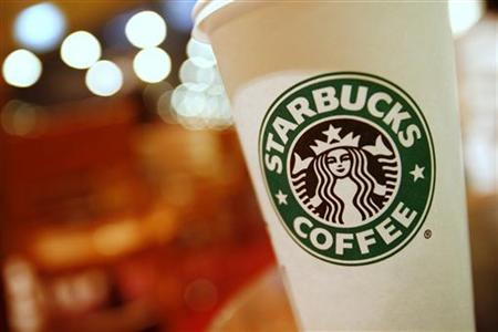 A cup of Starbucks coffee sits on a table in a cafe in central Hong Kong January 16, 2011.REUTERS/Joel Boh