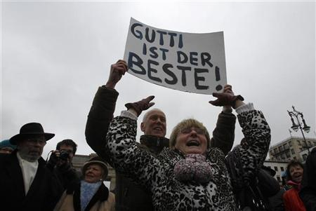 Protesters hold banner reading 'Gutti is the best!' (referring to German former Defence Minister Karl-Theodor zu Guttenberg) during a demonstration in Berlin, March 5, 2011. REUTERS/Tobias Schwarz