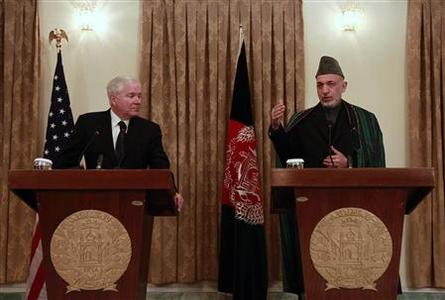 Afghanistan's President Hamid Karzai (R) speaks as U.S. Defense Secretary Robert Gates looks on during a news conference in Kabul March 7, 2011. REUTERS/Omar Sobhani
