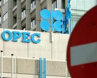 <p>The OPEC logo is seen on the rooftop of Vienna's OPEC headquarters during a formal meeting of OPEC oil ministers September 27, 2001. REUTERS/Heinz-Peter Bader HP/</p>