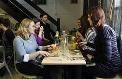 <p>Diners attend a Lex Eat brunch at an apartment in London, March 5, 2011. REUTERS/Simon Newman</p>