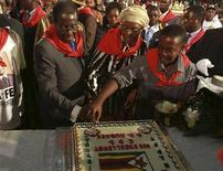 <p>Zimbabwean President Robert Mugabe, accompanied by his wife Grace, cuts a cake as he celebrates his birthday at a rally organised by his ZANU-PF party in Harare February 26, 2011. REUTERS/Philimon Bulawayo</p>