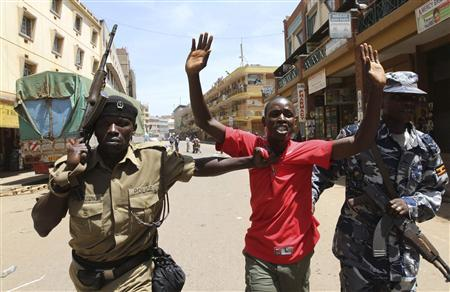 Ugandan policemen arrest a protester from the opposition parties during a political demonstration in the capital Kampala March 9, 2011. REUTERS/James Akena