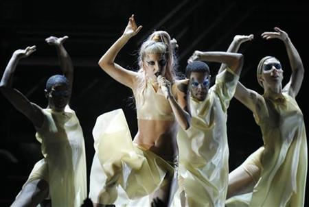 Lady Gaga (C) performs her new song ''Born This Way'' at the 53rd annual Grammy Awards in Los Angeles, California February 13, 2011. REUTERS/Lucy Nicholson