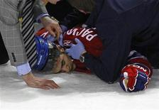 <p>Montreal Canadiens left wing Max Pacioretty is treated as he lies on the ice after being hit by Boston Bruins defenseman Zdeno Chara during the second period of NHL hockey play in Montreal, March 8, 2011. REUTERS/Shaun Best</p>