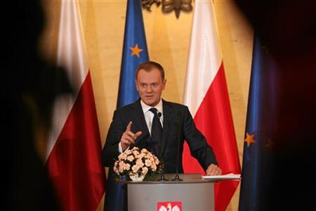 Poland's Prime Minister Donald Tusk gestures as he speaks during a news conference about changes in the pension system in Warsaw, March 8, 2011. REUTERS/Slawomir Kaminski/Agencja Gazeta