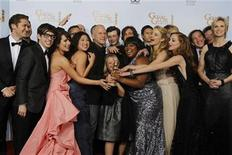 "<p>Ryan Murphy (5th L), creator of the TV series ""Glee"", and cast members pose with the award for best television comedy series at the 68th annual Golden Globe Awards in Beverly Hills, California, January 16, 2011. REUTERS/Lucy Nicholson</p>"