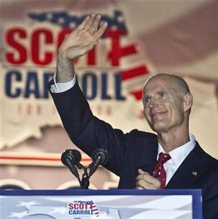 Florida Republican gubernatorial candidate Rick Scott greets the crowd at the outdoor site where he held his election night rally in Ft Lauderdale, Florida, November 3, 2010. REUTERS/Andrew Innerarity