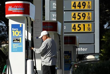 Gasoline prices are shown as a customer purchases fuel at a gas station in Del Mar, California March 9, 2011. REUTERS/Mike Blake